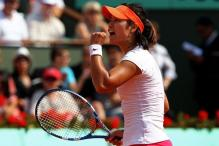Li Na celebrates a point during the 2011 French Open finals.JPG