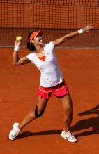 Li Na tosses a tennis ball to the crowd in jubilation after winning the 2011 French Open.JPG