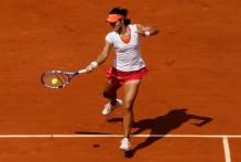 Li Na goes for the powerful inside out forehand on red clay.JPG
