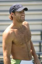 Robby Ginepri smiles in baseball cap without a shirt on.jpg