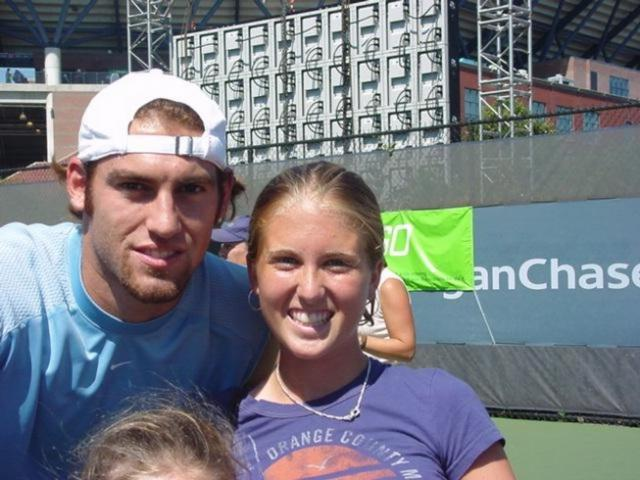 Robby Ginepri takes a picture with a girl fan.jpg