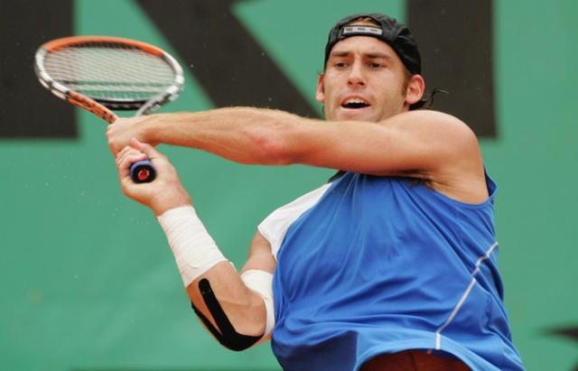 Robby Ginepri two-handed backhand followthrough.jpg