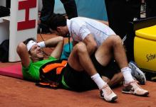 Juan Martin Del Potro is in pain at 2011 French Open.JPG