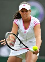 Laura Robson goes for a backhand drop shot volley at 2011 Wimbledon.JPG
