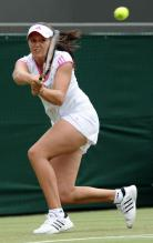 Laura Robson 2 handed backhand on the run during Wimbledon 2011.JPG