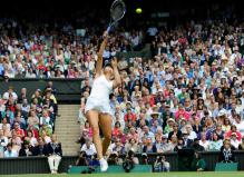 Maria Sharapova hits a difficult overhead at the Wimbledon 2011.JPG