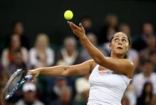 Tamira Paszek tosses the ball during her service motion.JPG