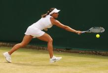 Tamira Paszek tries to track down a ball with a one handed backhand.JPG