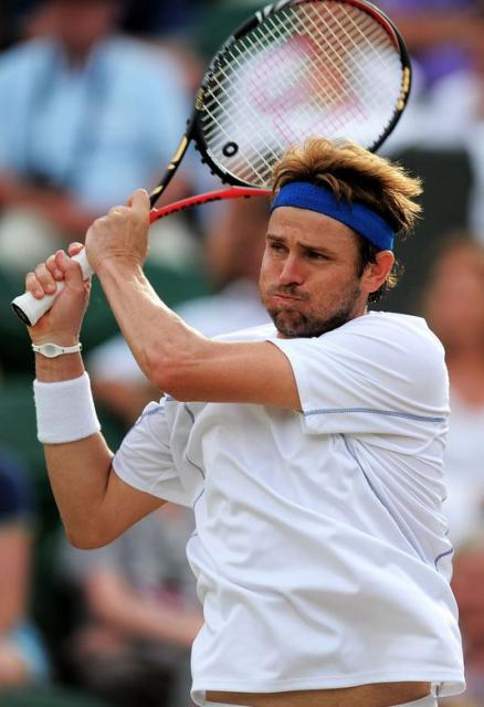 Mardy Fish double handed backhand follow through during 2011 Wimbledon.JPG