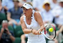 Caroline Wozniacki 2 handed backhand at contact during 2011 Wimbledon.JPG