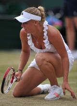 Caroline Wozniacki right knee on the ground during 2011 Wimbledon.JPG
