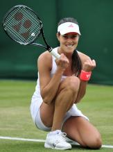 Ana Ivanovic smiles and celebrates a point during 2011 Wimbledon.JPG