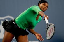 Serena Williams follows through on her serve at Stanford 2011.JPG