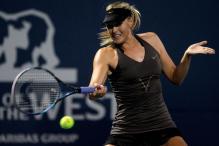 Maria Sharapova strikes a forehand at Stanford 2011.JPG