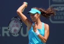 Ana Ivanovic follows through on a reverse forehand at Carlsbad 2011.JPG