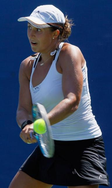 Tamira Paszek 2 handed backhand in black skirt and white top at Carlsbad 2011.JPG