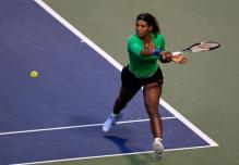 Serena Williams backhand slice on the run during Rogers Cup 2011.JPG