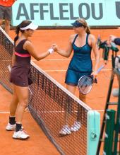 Ana Ivanovic shakes hands with Maria Sharapova after their match.jpg