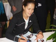 Ana Ivanovic signs autographs for fans.jpg