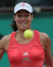 Ana Ivanovic stares at a ball in front of her in this funny picture.jpg