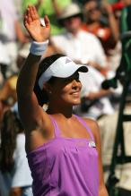 Ana Ivanovic waves to the crowd in purple outfit.jpg