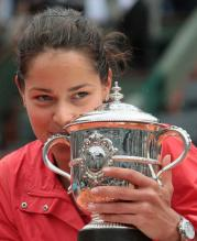 Anna Ivanovic holds her French Open trophy close.jpg
