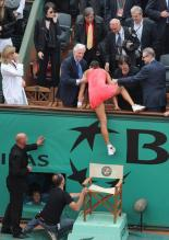Ana Ivanovic climbs over into the stands.jpg