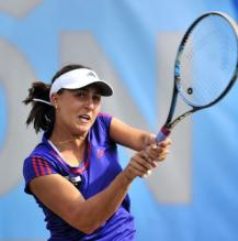 Tamira Paszek 2 handed backhand follow through at AEGON 2012.JPG