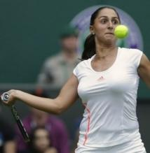 Tamira Paszek racquet back forehand preparation at 2012 Wimbledon.JPG