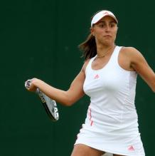 Tamira Paszek looks to hit a forehand at 2012 Wimbledon.JPG