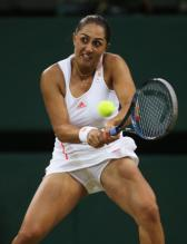 Tamira Paszek 2 handed backhand with open stance during 2012 Wimbledon.JPG