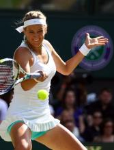 Victoria Azarenka about to hit a topspin forehand during 2012 Wimbledon.JPG