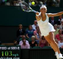 Victoria Azarenka stretches to try and return a high bouncing serve with the forehand at Wimbledon 2012.JPG