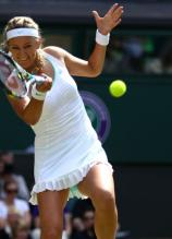 Victoria Azarenka forehand technique with front leg lifting up at 2012 Wimbledon.JPG