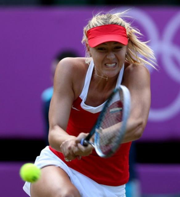 Maria Sharapova bends down to hit a 2 handed backhand at ...
