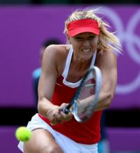 Maria Sharapova bends down to hit a 2 handed backhand at the 2012 Olympics.JPG