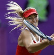 Maria Sharapova goes for a forehand volley during the Olympics 2012.JPG