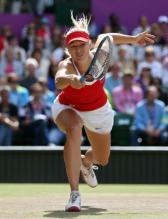 Maria Sharapova tries to reach the ball with a desperate 1 handed backhand lunge at the 2012 Olympics.JPG