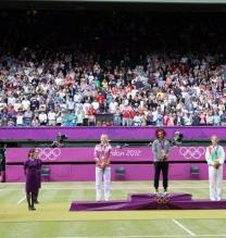 Maria Sharapova stands on the podium next to Serena Williams and Victoria Azarenka during the 2012 Olympics.JPG