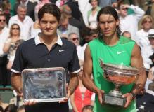 Rafael Nadal holds the French Open trophy while Federer holds the 2nd place trophy.jpg