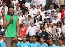 Rafael Nadal holds the microphone after winning the 2008 French Open.jpg