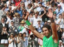 Rafael Nadal raises his arms in celebration of his 2008 French Open championship win.jpg