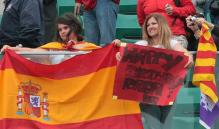 Rafael Nadal fans hold up the Spanish flag and banner.jpg
