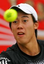 Kei Nishikori stares at the tennis ball.jpg