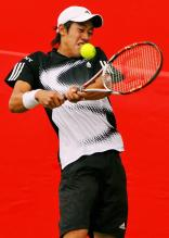 Kei Nishikori fights off a backhand.jpg