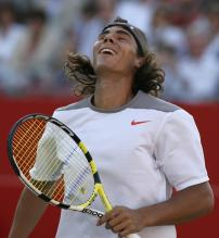Rafael Nadal reacts after a point during his doubles match.jpg