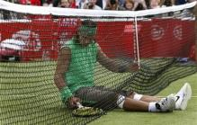 Nadal falls into the net.jpg