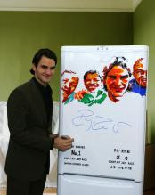 Roger Federer stands next to a poster honoring his number one ATP standing.jpg