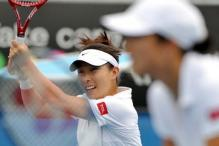 Zheng Jie hits a shot during her doubles match.jpg