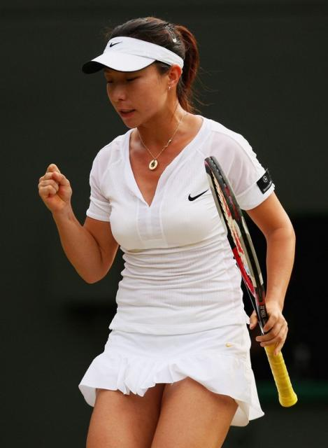 Zheng Jie in short white Nike skirt during Wimbledon 2008.jpg